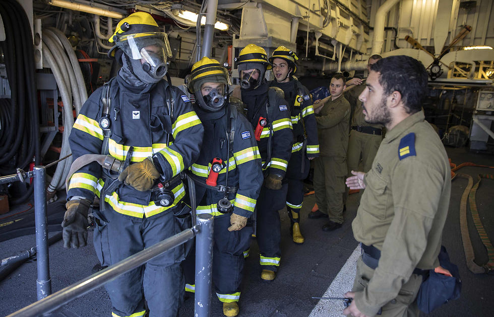 Israeli sailors onboard the INS Hanit take part in a fire evacuation exercise. (Photo: AFP)