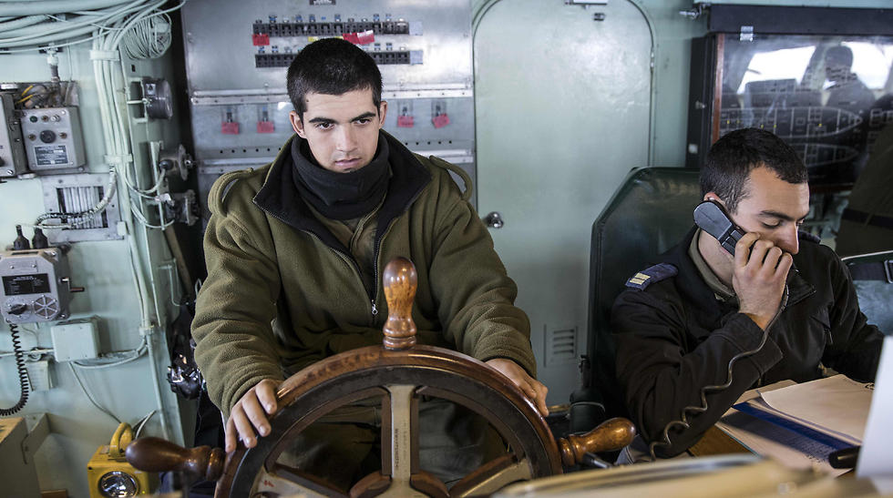 Israeli sailors onboard the INS Hanit maneuver the ship. (Photo: AFP)