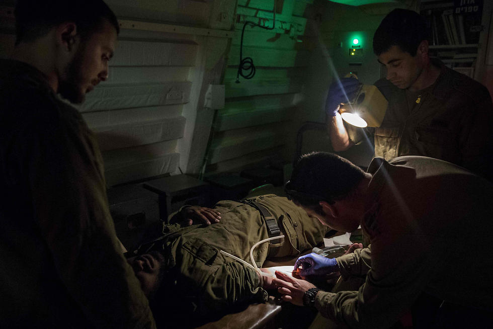 Israeli sailors onboard the INS Hanit attend a medical training session. (Photo: AFP)