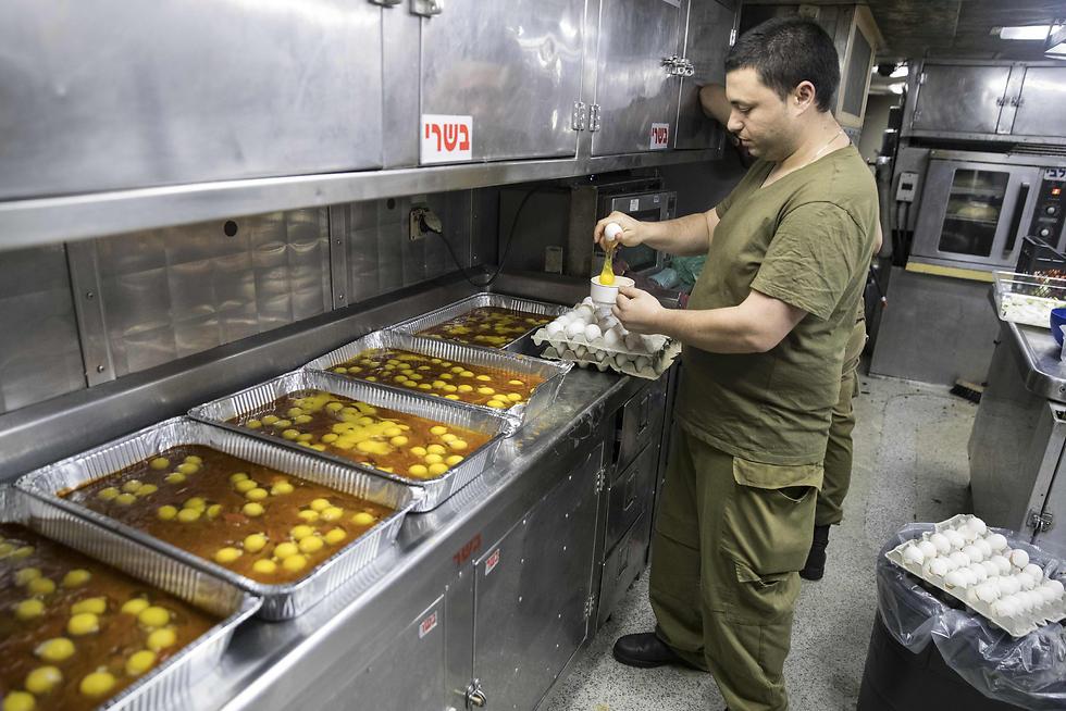 An Israeli sailor onboard the INS Hanit prepares food. (Photo: AFP)