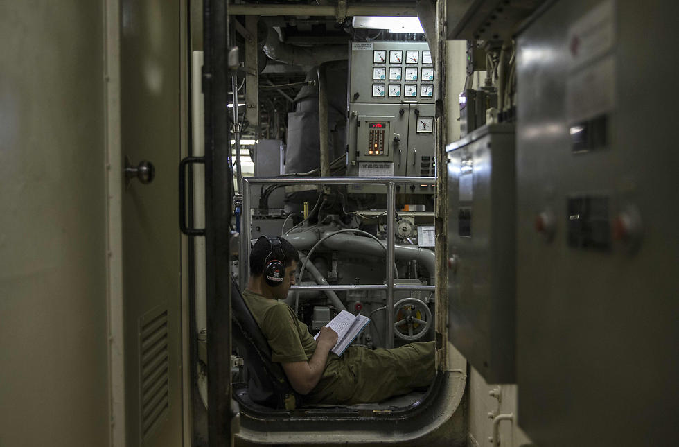 An Israeli sailor onboard the INS Hanit reads after a training session. (Photo: AFP)