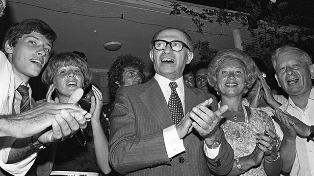 Menachem Begin celebrates 1977 election win. Brought religion into the coalition