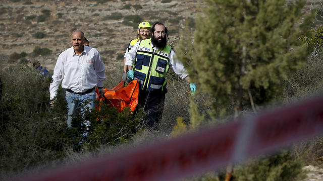 Rescue workers bring the body of Kristine Luken in 2010 (Photo: AP) (Photo: AP)