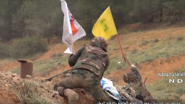 Militia soliders simulating taking over an Israeli post