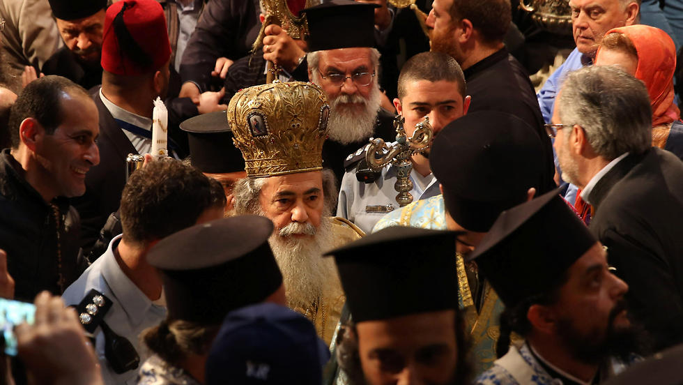 Greek Orthodox Patriarch of Jerusalem Theophilos III (C) leads the ceremony. (Photo: AFP)