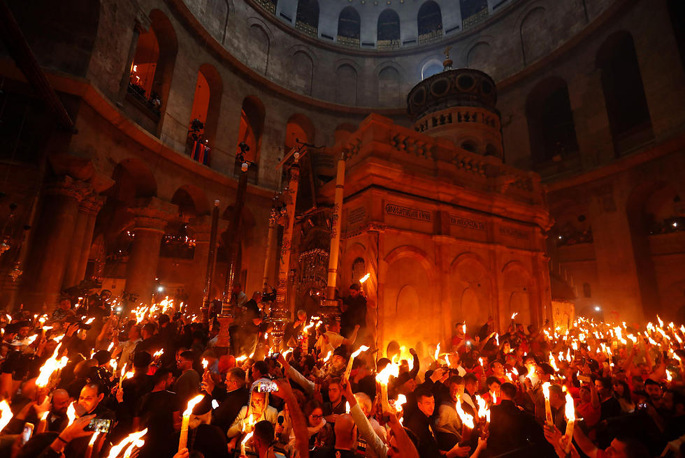 Worshippers inside the Church of the Holy Sepulchre (Photo: AFP)