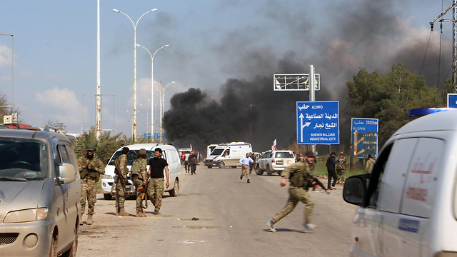 Running from the area of the blast (Photo: AFP)