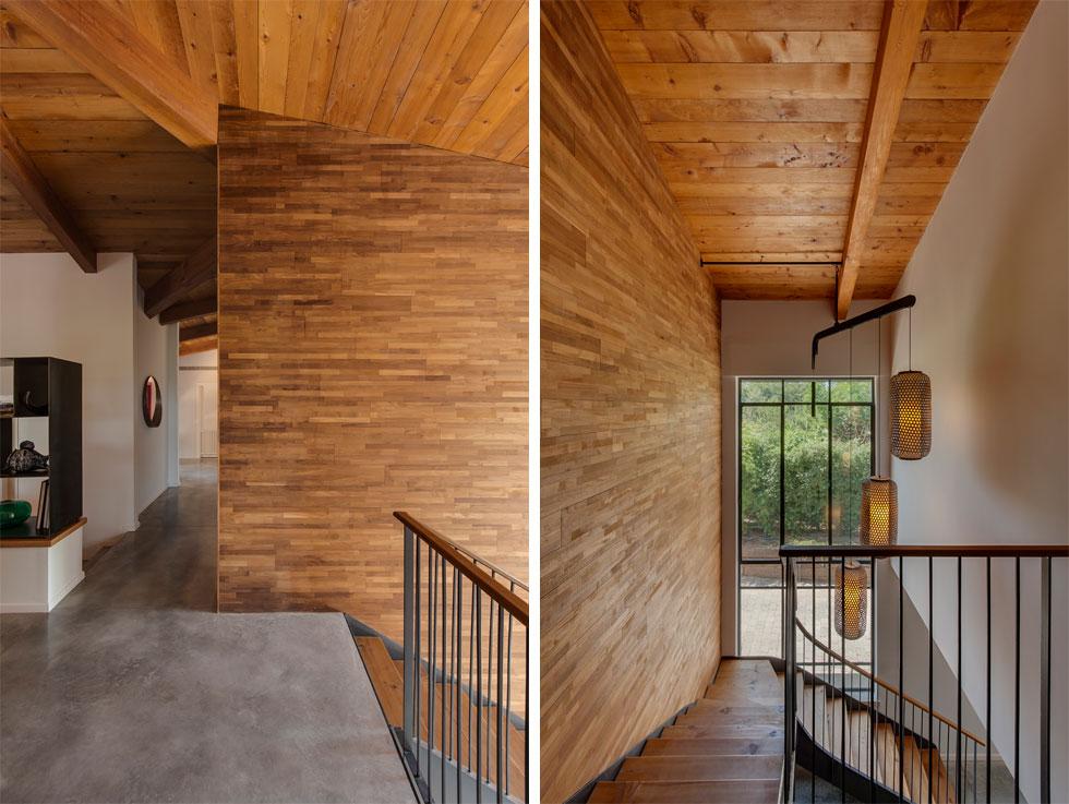 מימין: המדרגות היורדות לקומת המרתף, עם חלון גדול לכל גובהן. משמאל: המסדרון של חדרי השינה (צילום: עודד סמדר)
