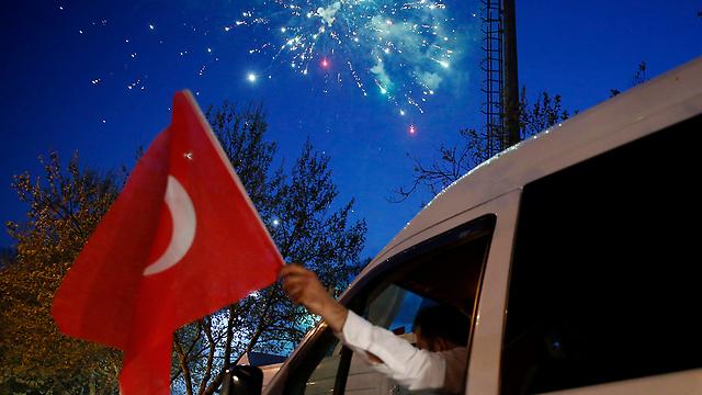 Celebrating the referendum results in Turkey (Photo: EPA)
