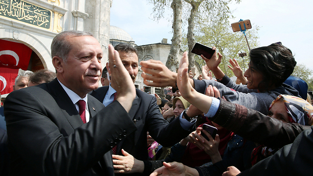 Erdoğan high-fives a supporter. (Photo: Reuters)