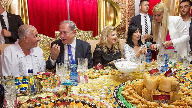 Prime Minister Benjamin Netanyahu and his wife attend a Mimouna in Hadera (Photo: Ido Erez)