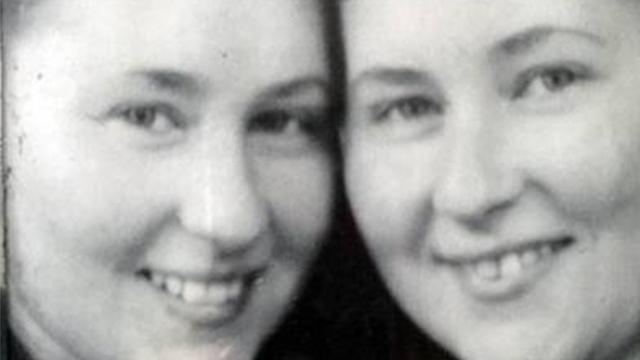 Identical twin sisters Tsesha and Amalia, who survived Auschwitz