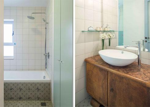 בחדר האמבטיה שידת כיור עתיקה מעץ ומרצפות מאוירות (צילום: גל דרן)