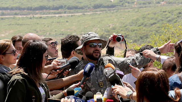 Hezbollah officer speaking to the press (Photo: EPA)