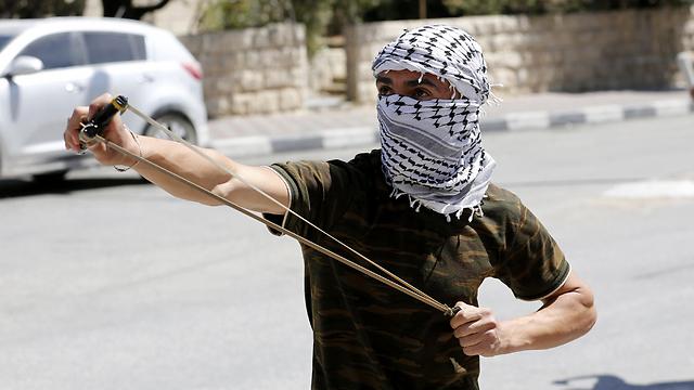 הפגנות של פלסטינים במהלך יום הזעם בחודש אפריל (צילום: EPA)