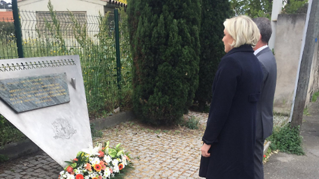 Le Pen lays a spray of flowers