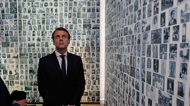 French President Emmanuel Macron and British Prime Minister Theresa May at a Holocaust memorial in Paris (Photo: Reuters)