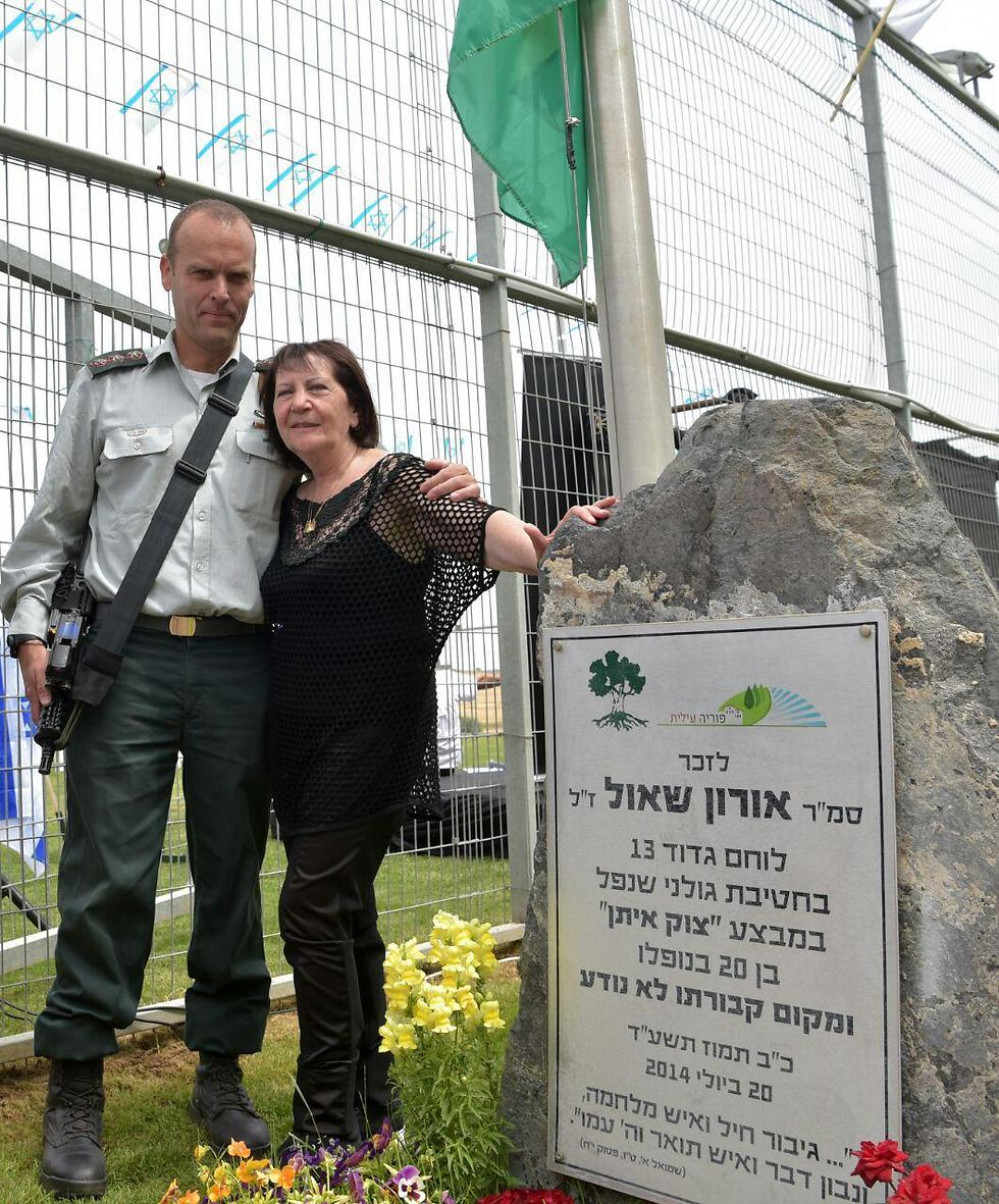 Zehava Shaul with the Golani brigade commander at a memorial for Oron