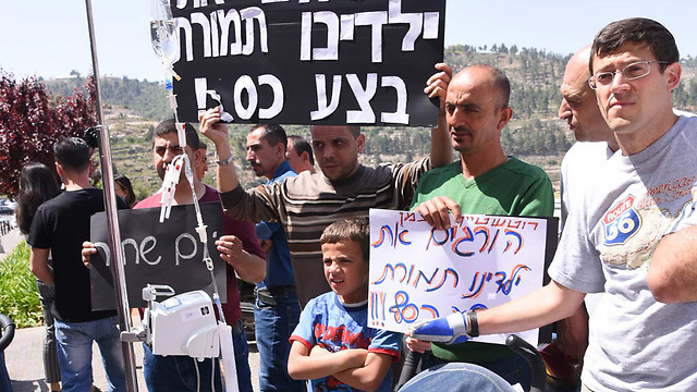 Protestors claim the doctors 'are killing our children to get more money.' (Photo: Yisrael Hadari)