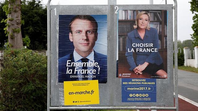 הקמפיין הסתיים. כרזות בחירות של שני המועמדים לנשיאות צרפת (צילום: רויטרס)