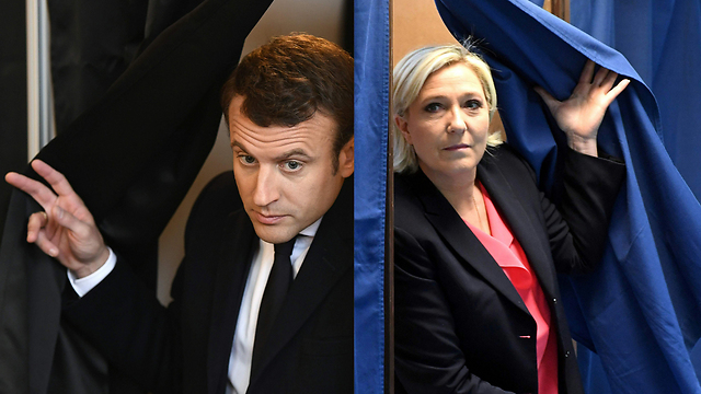 קו הסיום. לה פן ומקרון אחרי שהצביעו (צילום: AFP)