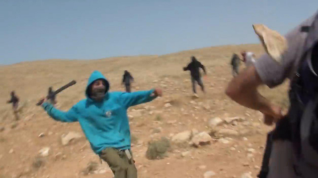 Jewish settlers attack left-wing activists and IDF soldiers in the West Bank.