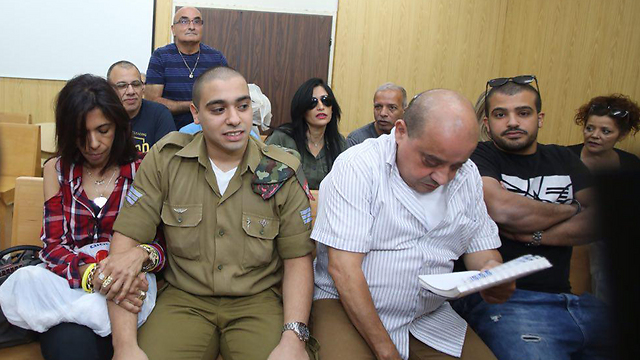 Elor Azaria in court with his parents to appeal his conviction (Photo: Motti Kimchi)