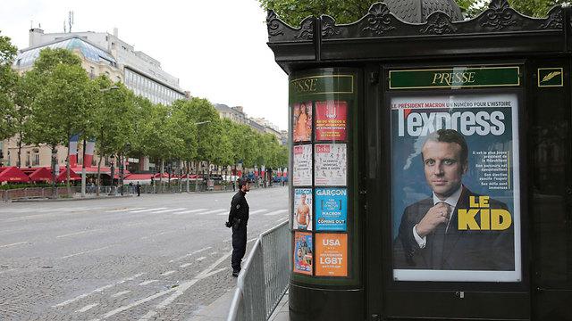 """""""הילד"""". כותרת העיתון L'express (צילום: AP)"""