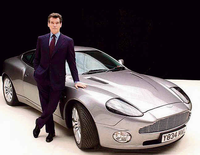 Pierce Brosnan with an Aston Martin Vanquish (Photo: United Artists, Danjaq LLC)