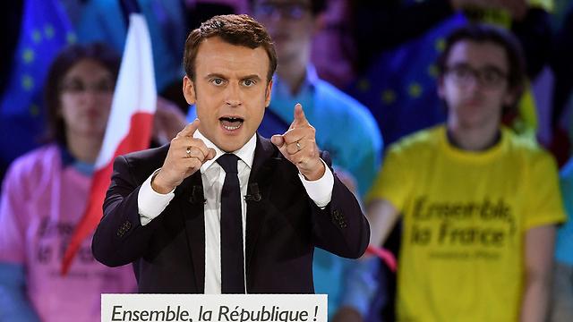 עשה היסטוריה וניצח את המפלגות הגדולות. מקרון (צילום: AFP)