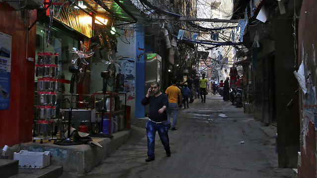 In this Thursday, May 4, 2017 photo, people walk inside the Bourj al-Barajneh Palestinian refugee camp in Beirut, Lebanon (Photo: AP) (Photo: AP)