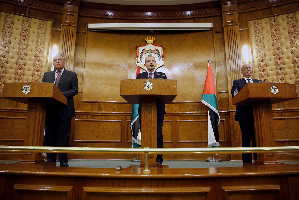 L to R: Shukri, Safadi and PLO chief Saeb Erekat (Photo: Reuters)