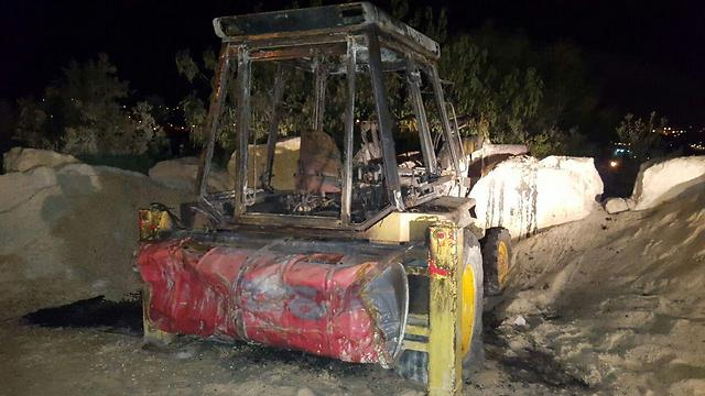 Incinerated tractor (Photo: Zacharia Sadeh)