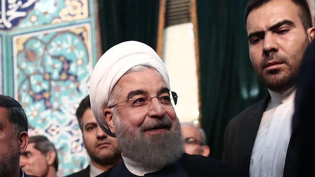 הנשיא האיראני חסן רוחאני (צילום: AFP)