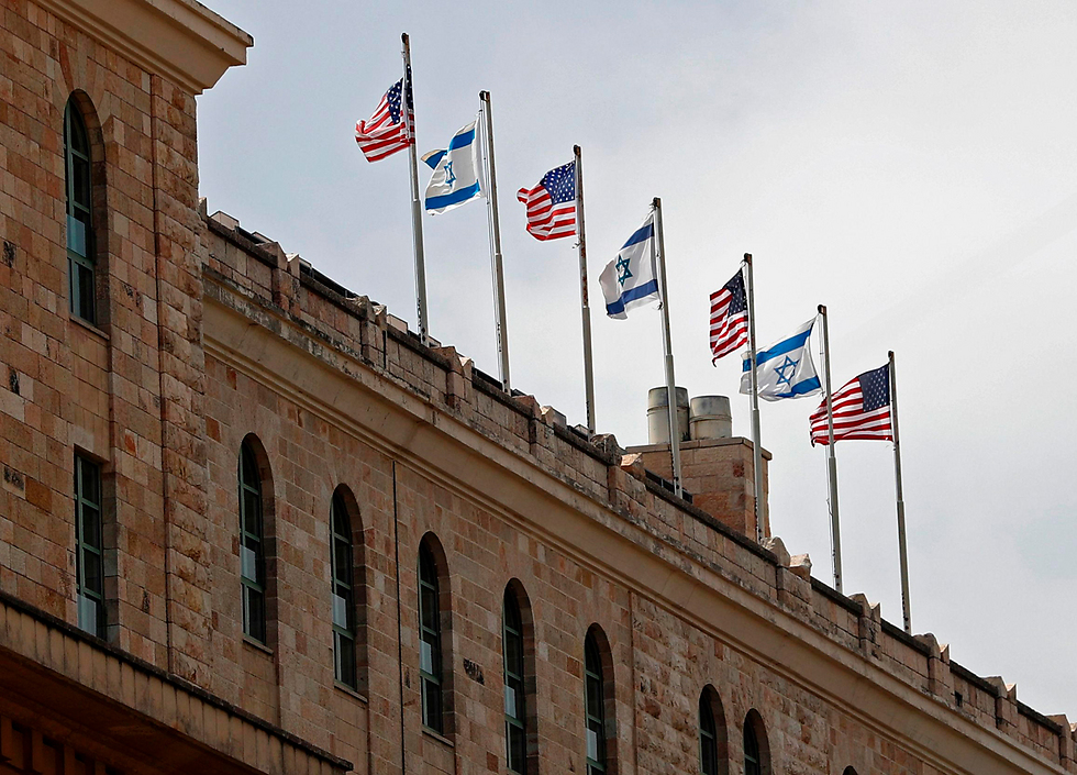 Flags atop the King David Hotel (Photo: AFP)