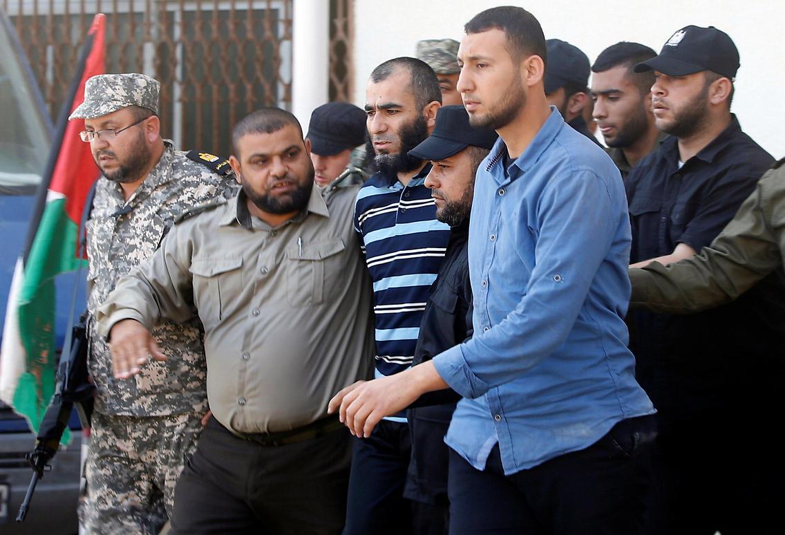 Ashraf Abu Layla, in the striped shirt (Photo: Reuters)