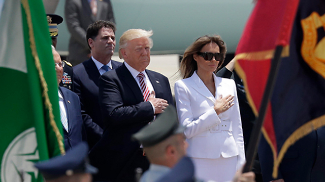 President Trump and First Lady Melania during the playing of the US national anthem (Photo: AP)