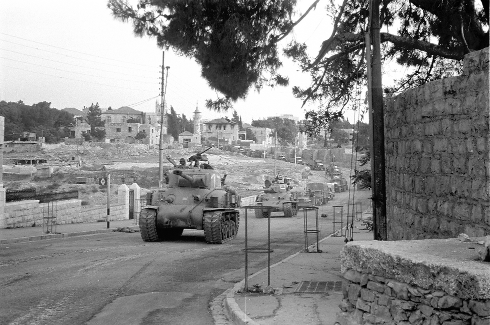 Super Sherman M-50 tanks make their way to conquer the Jordanian side of Jerusalem, backed by forces on trucks