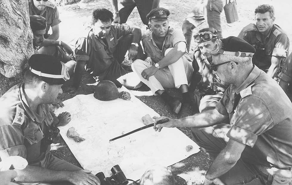 Colonel Uri Ben Ari, commander of the Harel Brigade, briefs his officers at the Central Command in the battle for the entrances to Jerusalem from the north