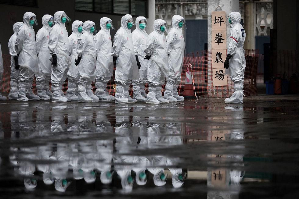 יותר מאלף חברים בשירות הסיוע האזרחי השתתפו בתרגיל חירום בהונג קונג שנמשך יומיים (צילום: AFP)