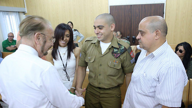 Azaria with his parents and his attorney, left (Photo: Motti Kimchi)