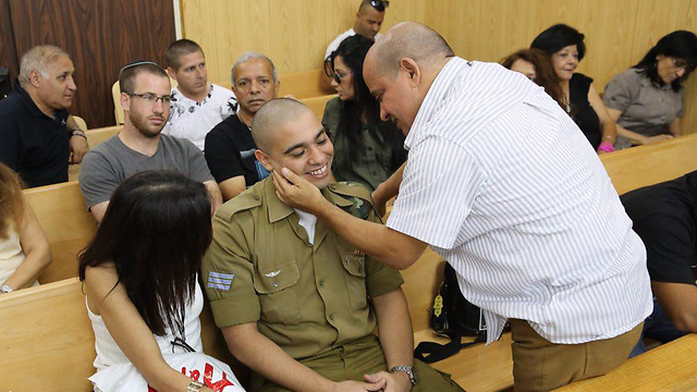 Sgt. Elor Azaria and his parents (Photo: Motti Kimchi)