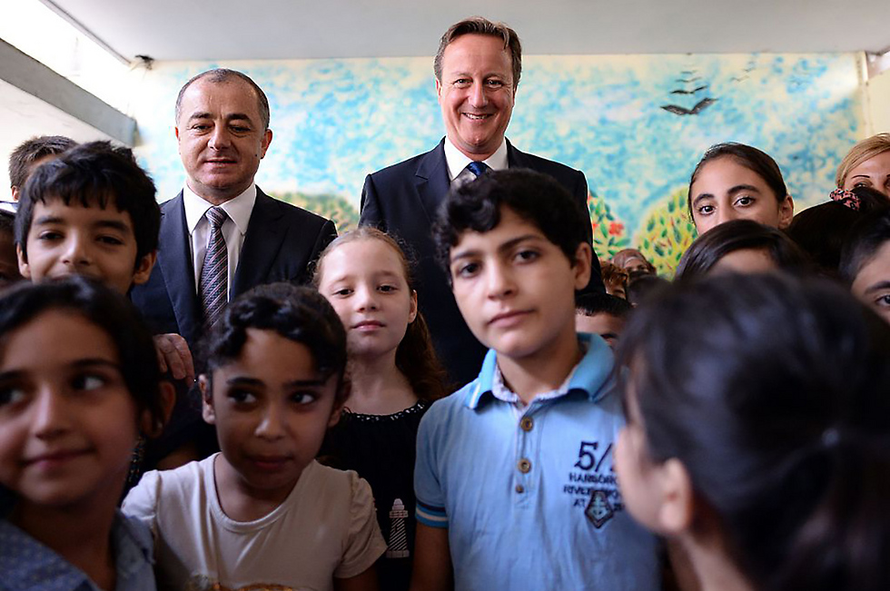 Former British Prime Minister David Cameron and former Minister of Education Elias Bou Saab, visiting a school in Beirut (Photo: Gettyimages)