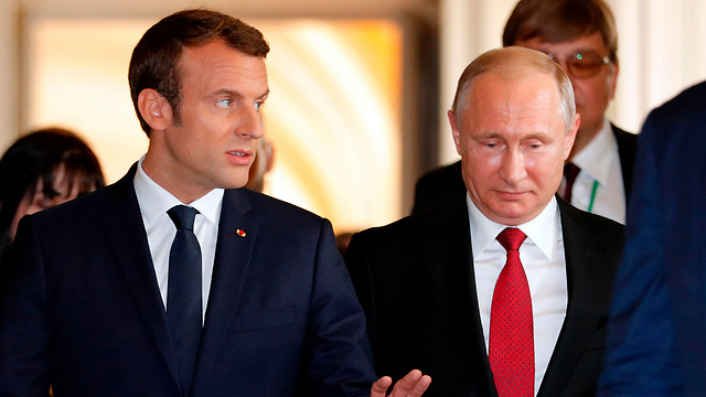 France's Macron(L) and Russia's Putin  (Photo: AFP)
