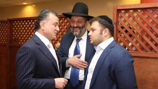 Mirilashvili and son with Deri (Photo: Yaacov Cohen, Kol Hazman Website)