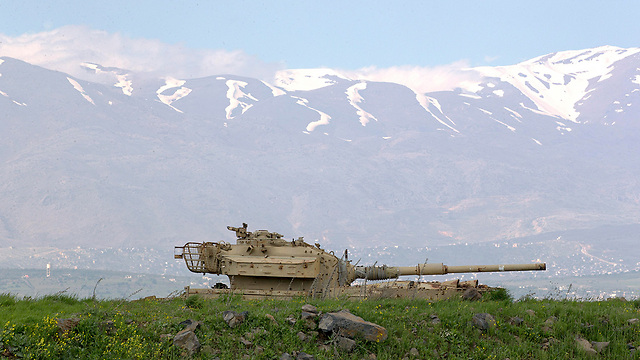 An IDF tank on the Syrian border in the Golan Heights (Photo: EPA)