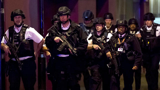 Armed police at the scene (Photo: EPA) (Photo: EPA)