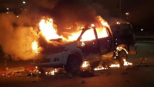 Police car burnt in the riot