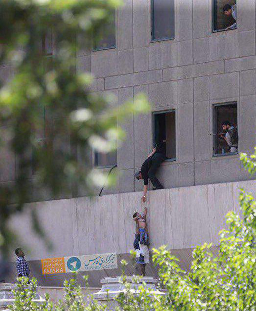 Hostages being rescued at the parliament building