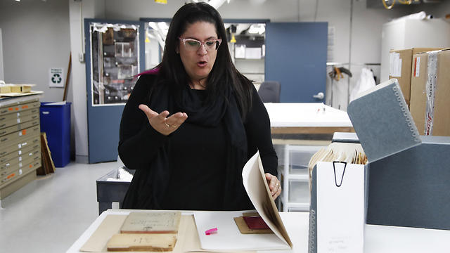 Curator Kyra Schuster, shows diaries laid on a table at the Holocaust Memorial Museum in Washington, Wednesday, June 7, 2017 (Photo: AP) (Photo: AP)